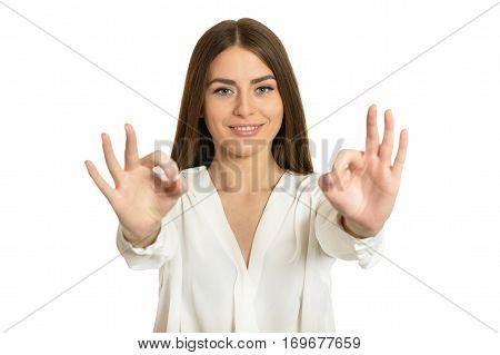 Beautiful woman in blouse showing ok sign on white background