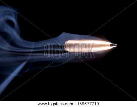Copper plated bullet with a polymer tip speeding with smoke