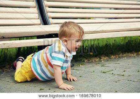 outdoor portrait of a funny playful boy. happy child on walk in the summer park