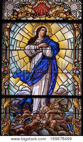 ZAGREB, CROATIA - DECEMBER 28: Virgin Mary, stained glass window in the Parish Church of the Visitation of the Virgin Mary in Zagreb, Croatia on December 28, 2015.