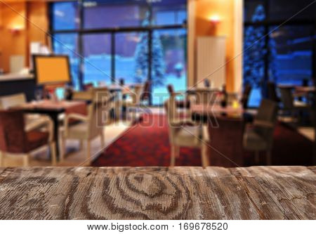 Empty Wooden Table Space Platform And Blurred Resturant Or Coffee Shop Background For Product Displa