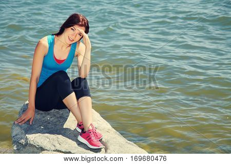 athletic woman on the background of the sea. freedom and a healthy lifestyle. harmonious person outdoors. the nature and vastness of the ocean. freedom