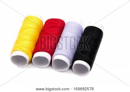 Colorful spools of thread isolated on white background