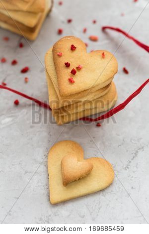 Top View of Homemade Heart Shaped Cookies on Grey Marble Table