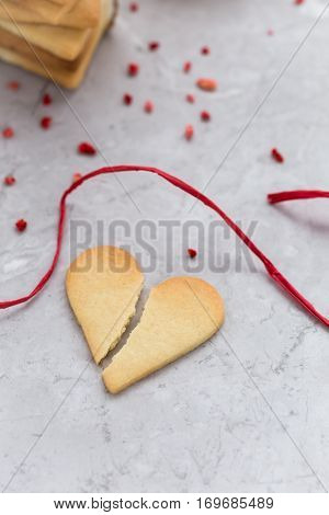Broken Heart Cookie on Grey Marble Table