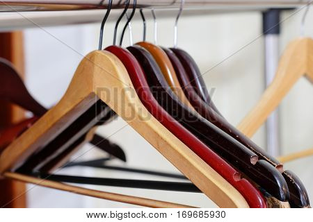 Hangers on a rail in a cloakroom