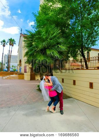 Las Vegas, United States of America - May 07, 2016: Wedding in Las Vegas at small white chapel. The groom kissing a bride at Las Vegas, USA on May 07, 2016