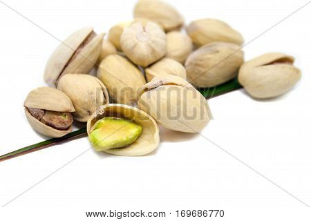 Pistachios On A White Background, Are Isolated.