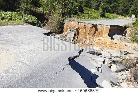 Road and pipes washed out after Hurricane Matthew in Raeford North Carolina