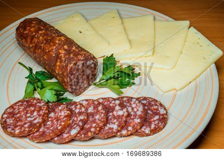 Fresh salami with cheddar and Swiss cheese and whole wheat crackers.