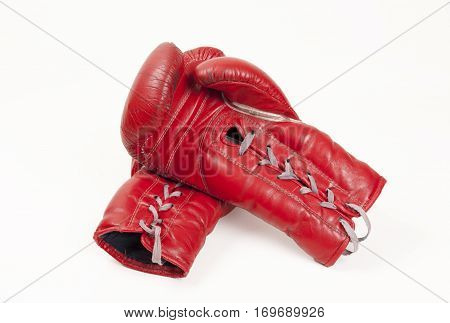 old used red leather boxing gloves concept putting hands together isolated on white background