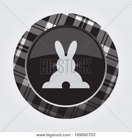 black isolated button with gray black and white tartan pattern on the border - light gray happy rabbit - rear view icon in front of a gray background