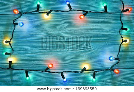 christmas garland lights on wooden rustic background