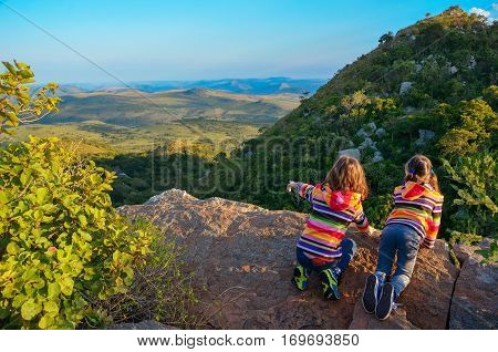 Family travel with children, kids looking from mountain viewpoint, holiday vacation in South Africa