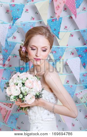 Bride.Young fashion model with  make up, ,curly hair, flowers in hair. Bride fashion. Jewelry and Beauty. Woman in white dress,perfect skin, blond hair. Girl with stylish haircut. .Wedding decoration