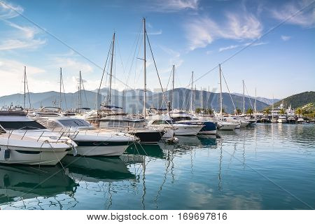 Yachts at the pier against mountains at dawn.