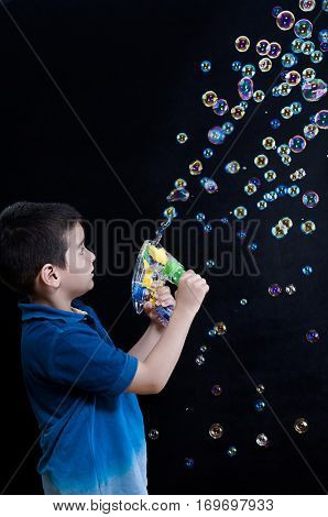 Child Playing with Bubble Wand