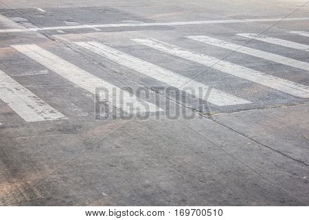 Crosswalk On The Bad Asphalt Road