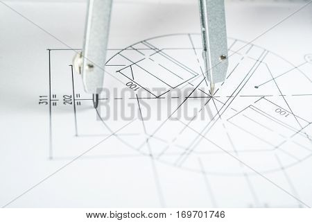 Macro shot of a compass on a technical drawing