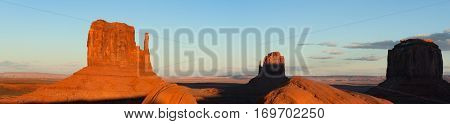 Panorama of Monument Valley formations at sunset, Arizona