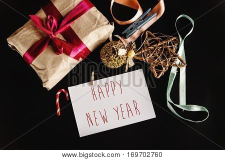 Beautiful Simple Present In Craft Paper With Ribbons, Greeting Card And Toys, Happy New Year Text