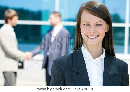 Successful young business woman with charming smile
