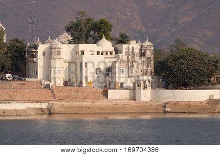 PUSHKAR, INDIA - FEBRUARY 17: Temples, buildings and ghats at the holy Pushkar Lake, Pushkar Sarovara, Hindu pilgrimage site, Rajasthan, India on February 17, 2016.