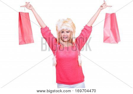 Woman In Furry Winter Hat Holding Shopping Bags