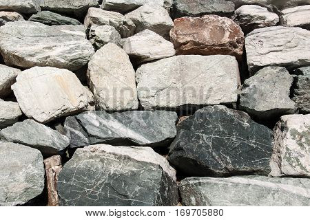 Old gray stacked stone as a wall, background
