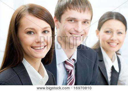 Three young professionals looking at camera