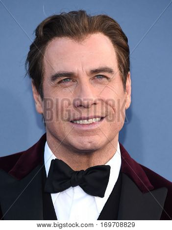 LOS ANGELES - DEC 11:  John Travolta arrives to the Critics' Choice Awards 2016 on December 11, 2016 in Hollywood, CA