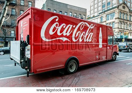 New York, February 6, 2017: A Coca-Cola truck is pulling into traffic on First Avenue in Manhattan.
