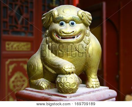 Ancient Figurine Of Funny Lion, Decorative Detail Of Chinese Taoist Temple