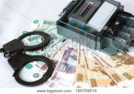 Energy meter and the handcuffs lying on Russian ruble