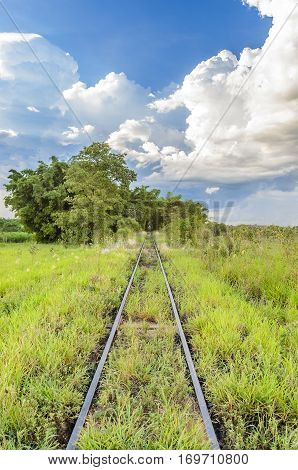 Train Track Passing Through A Green Field
