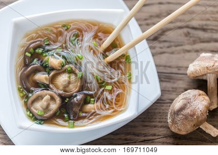 Bowl Of Shiitake Soup On The Wooden Table
