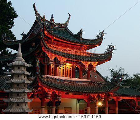 XIAMEN FUJIAN PROVINCE CHINA: Night view of South Putuo Temple (Nanputuo) famous Buddhist temple founded in Tang Dynasty Xiamen Fujian province China