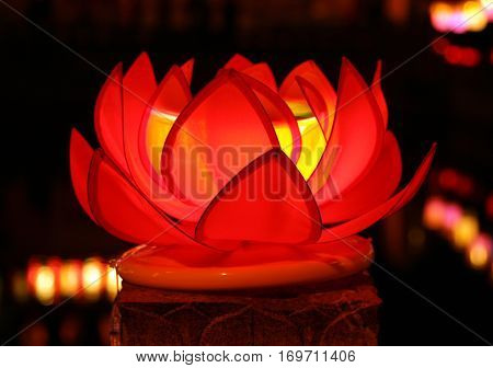 Beautiful red lotus with candle inside - traditional decoration of chinese buddhist temple symbol of purity