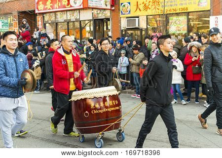 Chicago IL United States - February 5 2017: Members of Chicago Dragons Athletic Association participate in Chinese New Year's Parade in Chinatown Chicago IL.