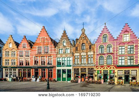 Colorful old brick houses in the Market Square in the UNESCO World Heritage Old Town of Bruges Belgium