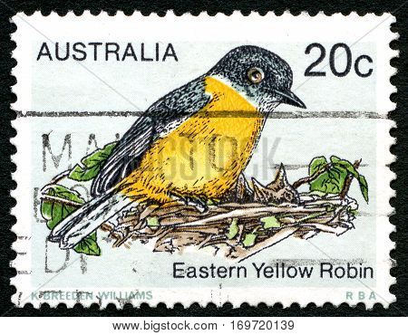 AUSTRALIA - CIRCA 1978: A used postage stamp from Australia depicting an illustration of an Eastern Yellow Robin circa 1978.