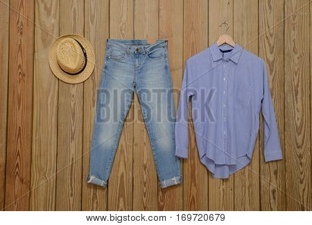 Blue denim jean with jeans shirt ,shirt on wooden background
