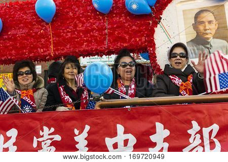 Chicago IL United States - February 5 2017: Older Asian women participate in Chinese New Year parade in Chinatown.