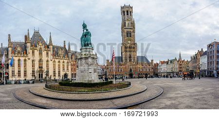 BRUGES, BELGIUM - JANUARY 27, 2017: Market square panorama in the UNESCO World Heritage Old Town of Bruges Belgium