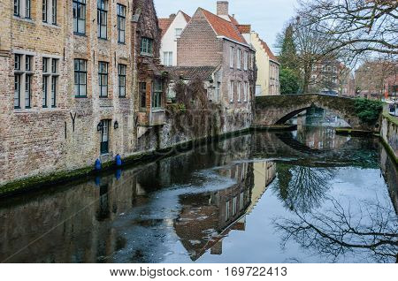 Reflections In The Canal In Bruges, Belgium
