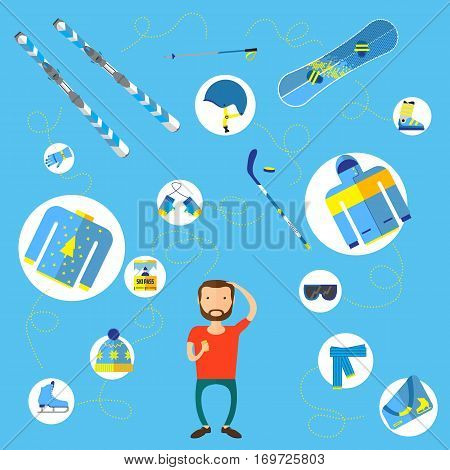 Athletic man standing surrounded by winter sport equipment and choose what to buy