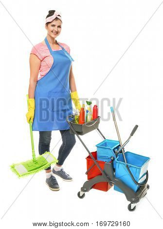 Young cleaner with cart and cleaning supplies on white background