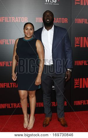 NEW YORK-JUL 11: Muhammad Wilkerson (R) and guest attend