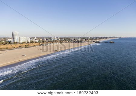Aerial of broad sandy beach in Santa Monica California.