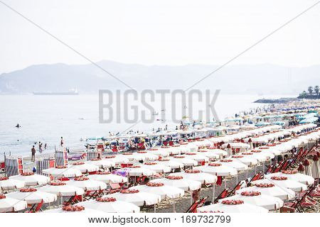 Beach with the wite umbrellas in Savona Italy